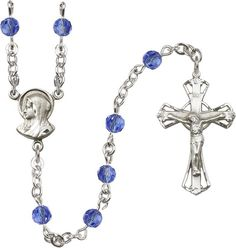 Sterling Silver Rosary features 5mm Sapphire Swarovski beads. The Crucifix measures 1 1/4 x 3/4. The centerpiece features a Madonna medal. Each Rosary is presen