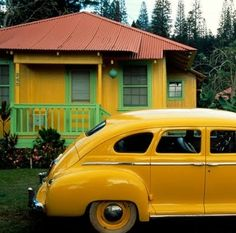 Hawaiian Plantation home, with a painted tin roof - and a matching Plymouth parked out front
