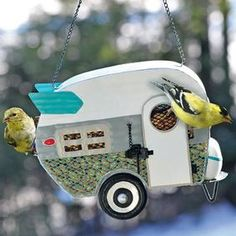 Camper Birdfeeder  @ Fresh Finds  is inspired by a retro 1950s camper design. Mesh screen is large enough for birds to grip and pull seeds and nuts through, but small enough to discourage squirrel visitors. Hang in a sheltered area to keep seed dry.