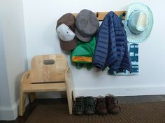 An organized entryway with a stool to assist the child when putting on shoes.