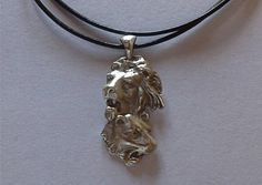 Large solid Sterling silver scenic lion and lioness pendant