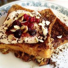 Tiramisu French Toast Recipe Breakfast and Brunch with white bread, eggs, cream, vanilla extract, kahlua, honey, butter, frozen mixed berries, sliced almonds, nonfat yogurt plain, cinnamon, unsweetened cocoa powder