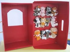 Finger puppet theater from a shoe box.   Love that you can store the puppets inside too!