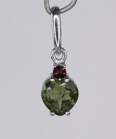 Faceted genuine 7 mm large Moldavite heart shape with small Garnet sterling silver pendant.This item is available in multiple quantity,each piece is more less the same.Price is per one pc) piece. More And Less, Ring Bracelet, Sterling Silver Pendants, Free Gifts, Heart Shapes, Garnet, Belly Button Rings, Jewelry, Granada