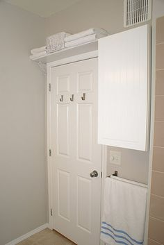 Small bathroom storage solutions  Shelf above door and double towel bar