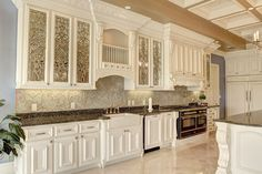 Beautiful kitchen with architectural millwork by White River Hardwoods! Assisted Living Facility, Kitchen Gallery, Luxury Kitchens, Kitchen Design, French Style Homes, New Kitchen Designs, Elegant Kitchens, Beveled Glass Doors, Kitchen And Bath