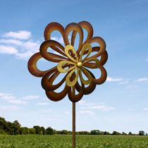 Iron petals twirl and spin in the breeze, performing a delightful dance in your yard or garden. This seven-foot-tall windmill features three rows of petals that spin in the wind.