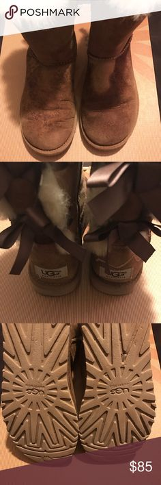 $85 Size 6 UGG Boots. Double Bow. Discoloration still has good sole. UGG Shoes Ankle Boots & Booties