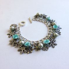 Turquoise pearl snowflake charm bracelet by FayeValentineJewelry on Etsy women's winter fashion