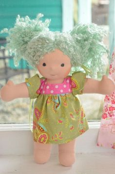 This is Daniella. She has fair skin, hair made with wool/mohair boucle in a Bamboletta blue color and blue-grey eyes. She is wearing the pictured outfit and underpants.