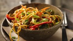 Pour beer-peanut sauce over pasta mixture that's featured with Green Giant® broccoli florets and veggies – a wonderful dinner.
