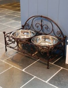 raised dog feeders. Very decorative. Ornate Iron.