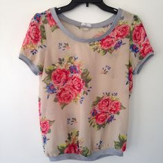 Pretty floral print sheer top small Cute with a tank top. Size small. Never used. Should fit up to a size 6 Tops Tunics