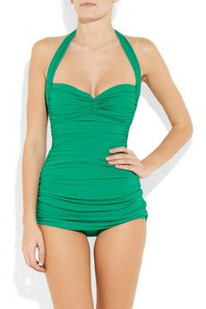 Ruched halterneck Norma Kamali swimsuit in jungle green could go any where with a skirt & sexy sandals.