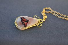 Butterfly pendant hand painted on polished stone by Ria Spencer ~ Canyon Black Jewelry