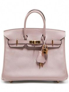 239066abf7cf Shop Hermès Vintage Birkin 25 bag  Valentino. Fashion Designers · Valentino  · Nano Collection by Louis Vuitton ...