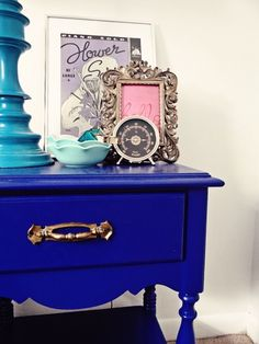 cobalt blue nightstand + teal-lamp + nightstand decor
