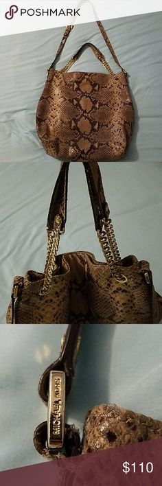 EUC Michael Kors Python Shoulder/Crossbody Bag Beautiful Authentic MICHAEL Michael Kors Python Bag! Plenty of space for all of your essentials! Tote this beauty on your arm, shoulder or across your chest as a crossbody, totally versatile! There is a small makeup mark on the inside of the bag that does not affect it's usage (see last pic). The bag itself is 16 1/2 L x 15 1/2 H. The long strap adjusts from 15 1/2-17 from the top of the bag. The shorter straps are 6 in from the top of the bag…