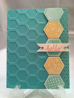 handmade card ... aqua with yellow highlights ... column of large stamped and punched hexagons separates honeycomb textures plain cardstock from thin edge of printed paper in the same color range ... like the bold and simpie design ... Stampin' Up!
