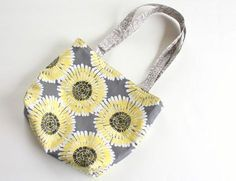 Simple tutorial for easy DIY fabric bag/purse tutorial made from a fat quarter. Great beginner sewing project. Kid friendly.
