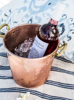 Copper ice bucket. Beachside picnic gathering. Image from What to Cook.