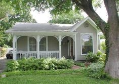 Cottage home in Alamo Heights\ porch arches and railings Cozy Cottage, Cottage Living, Cottage Homes, Cottage Ideas, Cozy House, Cottage Style, Alamo Heights, Small Bungalow, Tiny Cabins