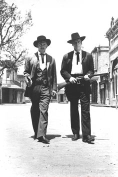 Kirk Douglas (L) as Dr. John 'Doc' Holliday and Burt Lancaster and Marshal Wyatt Earp walk toward camera carrying guns in a film still from the 1957 film 'Gunfight at the O.K. Corral. (Photo by Paramount Pictures/Courtesy of Hulton Archive/Getty Images)    Read more: http://www.answers.com/topic/gunfight-at-the-ok-corral-large-image#ixzz1rzaD8yEi