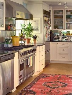 When we posted this kitchen, there was quite a bit of discussion about having a formal, antique rug in the kitchen
