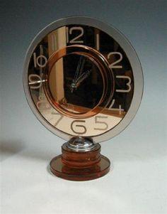 An Art Deco mirrored glass mantle clock