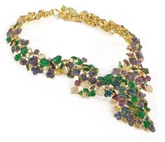 19,2k gold necklace Diamonds, Sapphires, Rubis and Emeralds weighting 78,17cts.