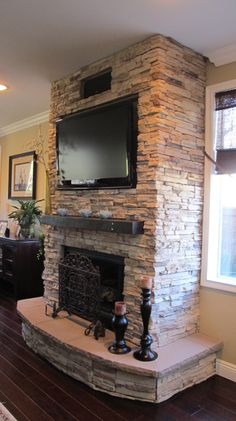 I want to put stone on our fireplace like this and paint the mantle same color as the buffet table the tv is on or a dark stain like this