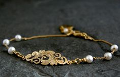 Check out this item in my Etsy shop https://www.etsy.com/listing/159599910/gold-bracelet-gold-pearl-wedding