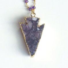 The Ultimate Boho Glam Piece! This stunning necklace is made with a chunky amethyst arrowhead pendant, electroplated in 24k gold, suspended on a