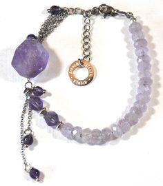 Amethyst unique stylish gemstone bracelet, natural faceted Amethyst beads with large Amethyst focus Length extender chain Amethyst faceted beads: Focal bead: natural Amethyst Spacers, chain & clasp: stainless steel - no tarnish Handmade Jewelry, Unique Jewelry, Handmade Gifts, Amethyst Bracelet, Easy Wear, Trending Outfits, Bracelets, Etsy, Vintage