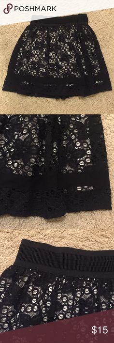 Flowy lace skirt Black and cream, two layers, thick elastic waistband, goes great with a jean jacket and tucked in tank top, medium/small fit. Good condition. No trades sorry. Skirts