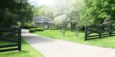 A sweeping driveway leads up to the home, which sits on two acres. The home's 1890 floorplan was that of an American Foursquare, or four rooms connected by a breezeway in the middle.   - HouseBeautiful.com