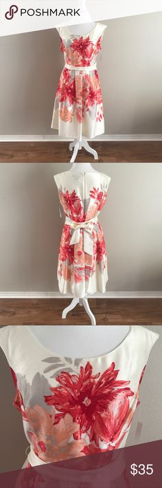 """Jessica Howard Women's  Floral Scoop Neck Dress NWT Printed shantung party dress with extended shoulder and scoop neckline.Tie waist and pleated skirt. 100% Polyster. Perfect for spring wedding and bridal showers. Size 14 Measurements: Bust- 19 1/2"""" Waist: 17"""" Hips: 20"""" Shoulder to Hem: 30"""" Jessica Howard Dresses"""