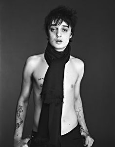 """Pete Doherty has several tattoos which seem to be a bit random in nature and location, including a tattoo design on his neck of his sons name """"Estile"""" which appears to be """"Astile."""