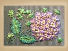 I ❤ ribbon embroidery . . . How to embroider a silk ribbon hydrangea & ivy group. www.craftyattic.com shows you how to embroider this beautiful hydrangea and ivy group in pure silk ribbon. All of the techniques you will need to embroider this panel are included.