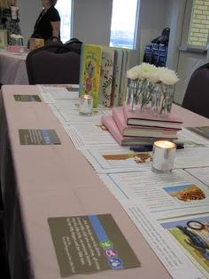 Build a Library baby shower. Gender Neutral baby shower. Book baby shower- décor, use solid color wrapping paper over large hardcover books and stack as centerpieces. Pages of books down the center of the table.
