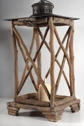 Twig lamp, would place candle in tall glass holder to make it safe and it can also be done with picture frames plus those come with glass already! ^_^