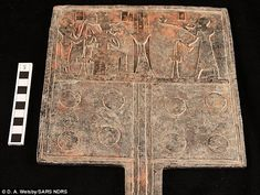 In one tomb below a pyramid, archaeologists found an offering table which features a carvi...