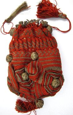 "Scarlet and gilt metal thread crocheted drawstring purse, circa the mid 19th century. Three dimensional floral forms, decorative gold thread-covered balls, and tassels. Measures 5"" by 3 3/4"" not including bottom tassel."