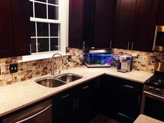 Kitchen Remodel by M.A.K. Construction Services- Craftsman Java Maple Wood Cabinets, Silestone Countertops, Stainless Steel Undermount Double Sink, Stainless Steel Appliances, Backsplash- Glass Subway Tile