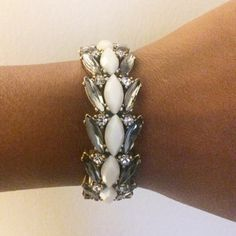 J.Crew Crystal, White Stone Statement Bracelet Elastic band. White and gold.  Great wardrobe accent.  I also have the same bracelet with blue stones. Scroll to previous post. I'm willing to bundle if interested! J. Crew Jewelry Bracelets