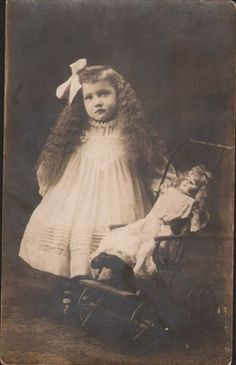 AC178 Vintage RPPC Girl with Long Hair Doll in Buggy