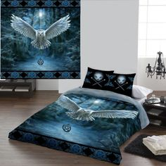 Anne Stokes Awaken Your Magic Gothic Bedding Set for Double Duvet. Stunning double size duvet cover set. The Fantasy artwork of Anne Stokes adorns this beautiful duvet cover in shades of blue. The duvet cover features an owl flying from a moonlight forest carrying a pentagram necklace edged in a pentagram and