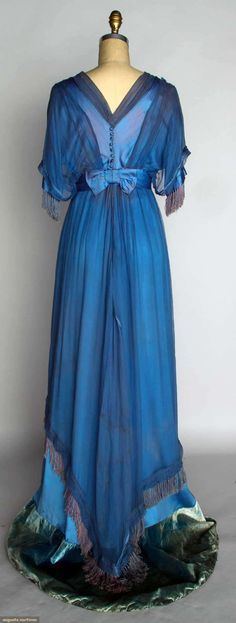 "SILK EDWARDIAN EVENING GOWN, c. 1912  Go Back November 13, 2013 - NYC New York City Powder blue silk satin w/ blue chiffon overdress, ribbon rosette trim, trained skirt w/ velvet hem band, B 36"", W 28"", L 63""-73""."