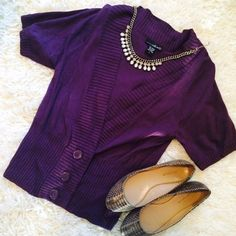 Gorgeous Eggplant Cardigan with Buttons! Gorgeous Eggplant Cardigan with Buttons! Deep v-neck with short sleeves. In perfect condition...I bought it because it's a beautiful color and super comfy but I never wear it  should go to someone who looks good in purple!  shoes and necklace in cover photo not for sale. Willi Smith Sweaters Cardigans