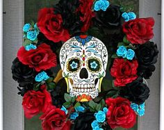 This vibrant day of the dead wreath is made on an 18 white grapevine wreath frame. At the longest point, this wreath measures Since the flowers are large and full, this wreath will stick off the door approximately Black red and turqouise roses surr Halloween Wedding Centerpieces, Halloween Front Door Decorations, Halloween Front Doors, Scary Halloween, Fall Halloween, Halloween Crafts, Halloween Wreaths, Halloween 2018, Halloween Ideas